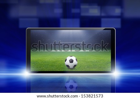 Technology, sports background - tablet pc, computer, soccer ball, sports game online, soccer online - stock photo