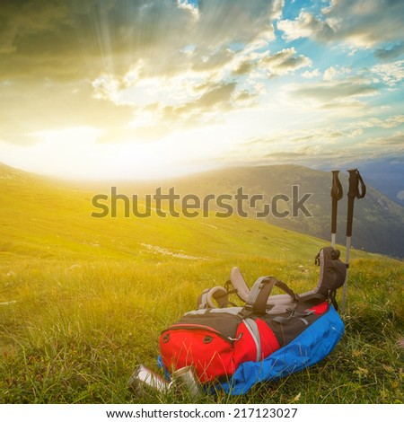 ted touristic backpack in a mountains - stock photo