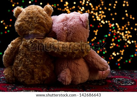 Teddie bear with white with red rose sitting with bokeh background - stock photo
