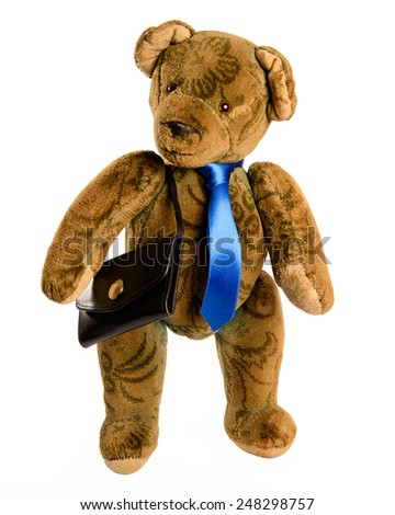 Teddy as a businessman with a blue tie and black briefcase. Studio shot isolated against white background isolated. - stock photo