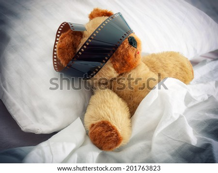 Teddy bear has some vivid almost movie dreams during sleep. - stock photo