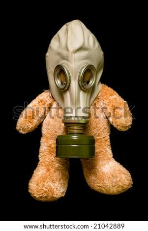 Teddy bear in a gas mask - stock photo