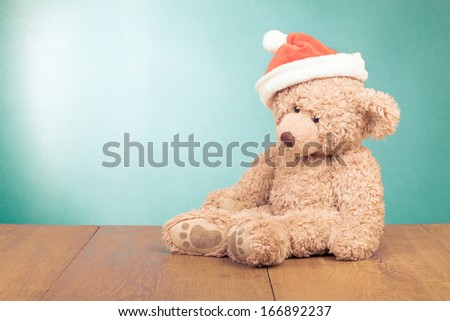 Teddy Bear in Santa hat for new year greeting card - stock photo
