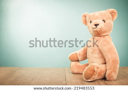 Teddy Bear old retro toy sitting front gradient background - stock photo