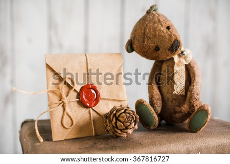 Teddy bear on a suitcase with love messages - stock photo