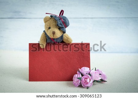 Teddy bear with blank red card - stock photo