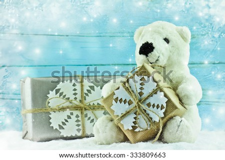Teddy bear with Christmas gift.  - stock photo