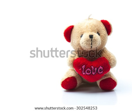 Teddy Bear with Love Heart on isolated background - stock photo