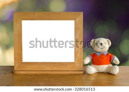 Teddy bears and picture frames on the table and have space for images or text. - stock photo