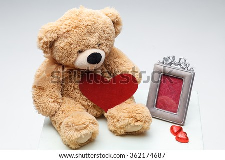 Teddy Bears couple with red heart. Valentines Day concept. - stock photo