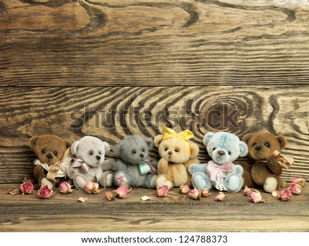 Teddy bears on wooden background - stock photo