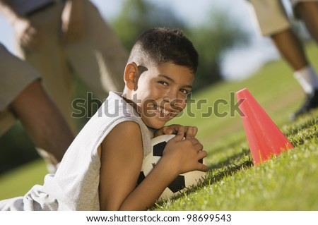 Teen Boy Guarding Soccer Ball - stock photo