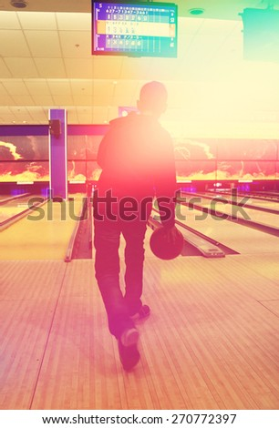 teen boy plays bowling - stock photo