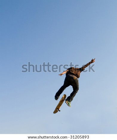 teen boy skateboarder on air - stock photo