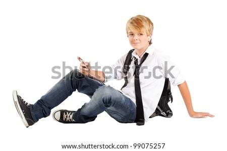 teen boy student sitting on floor isolated on white - stock photo