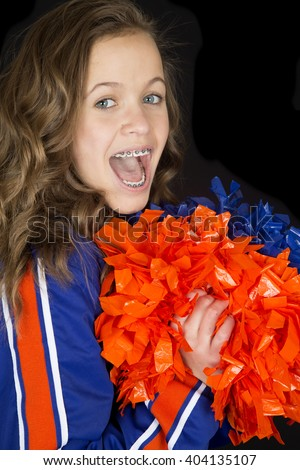 Teen cheerleader cheering excited mouth open braces - stock photo