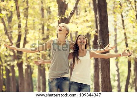 Teen couple at autumn park. - stock photo