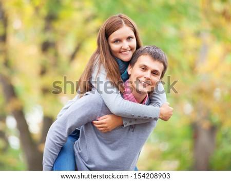 Teen couple at autumn park - stock photo