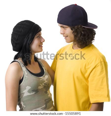 Teen couple in studio smiles - stock photo