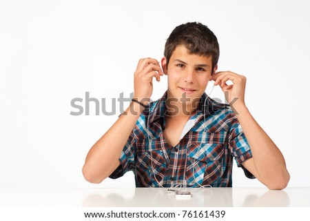 Teen enjoying his MP3 player, isolated on white - stock photo