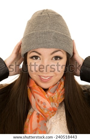 Teen female model adjusting her winter beanie - stock photo