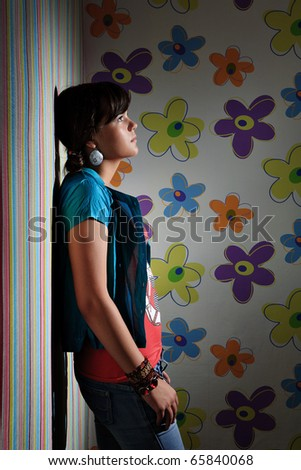 Teen girl against the wall - stock photo