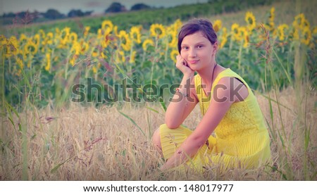 teen girl and sunflower in summer time - stock photo