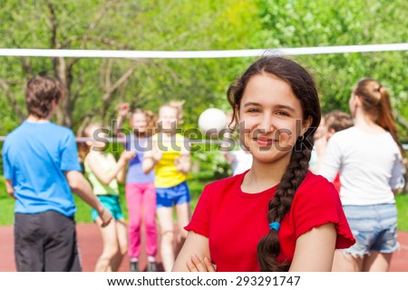Teen girl at volleyball game on the playground - stock photo