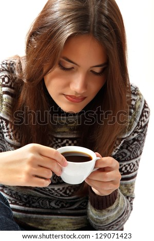 teen girl attractive drinking coffee over white - stock photo