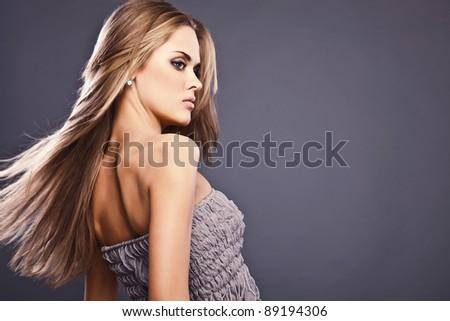 Teen girl beautiful cheerful enjoying on gray background - stock photo