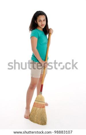 Teen Girl Doing Her Chore of Sweeping - stock photo