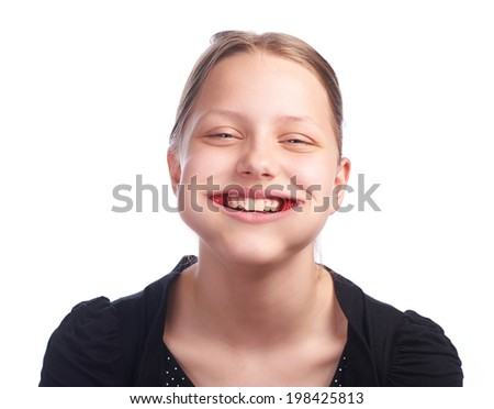 teen girl eating strawberry,studioshot - stock photo