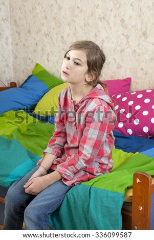 Teen girl frustration cry to sitting near bed - stock photo
