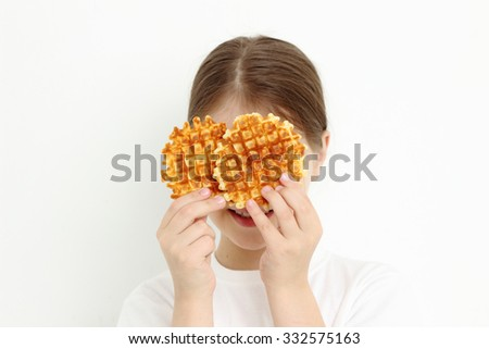 Teen girl holding waffles - stock photo