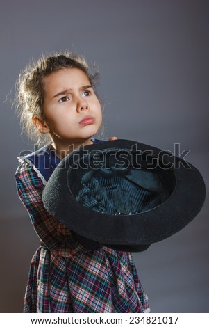 teen girl in a bright dress hat holding hands - stock photo
