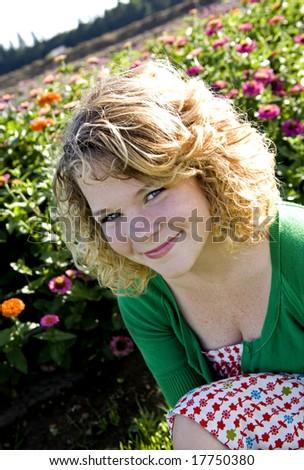 Teen girl  in a flower field - stock photo