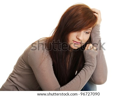 Teen girl in depression, isolated on white - stock photo