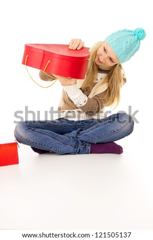 teen girl looks in a gift isolated - stock photo