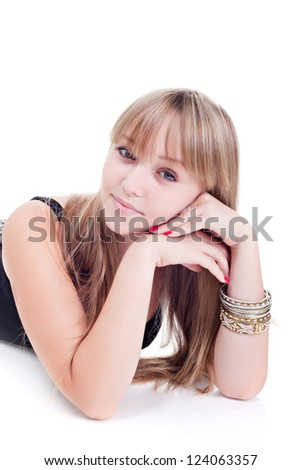 Teen girl lying down. Isolated on white background - stock photo
