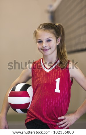 Teen girl on Volleyball court - stock photo