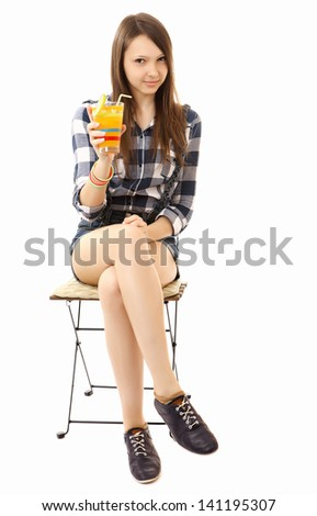 Teen Girl relaxing sitting on the folding chair with a cocktail in hand. One person, brown hair, caucasian appearance, teenage girl, female, 16 years old, vertical image, isolated on white background. - stock photo