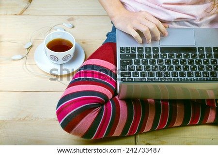 Teen girl sitting with a laptop  - stock photo