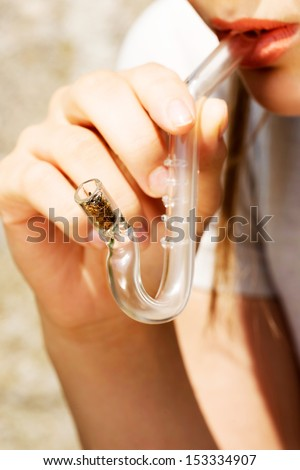 Teen Girl smoking cannabis outdoor. - stock photo