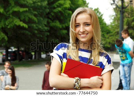teen girl student happy attractive outdoor portrait - stock photo