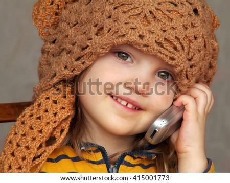 Teen girl talking on the phone - stock photo