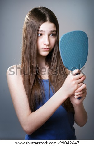 Teen girl unhappy with their appearance - stock photo