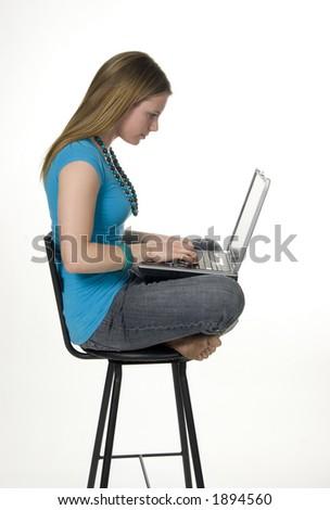 teen girl using laptop computer - stock photo