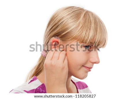 Teen girl wearing a hearing aid. Studio shot-isolated on white background. - stock photo