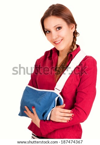 teen girl with broken arm in a sling, white background - stock photo