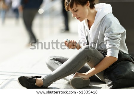 teen girl with cell-phone - stock photo